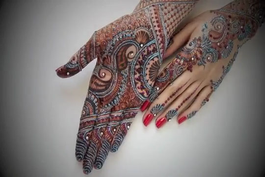 silver and blue glittter mehndi pattern