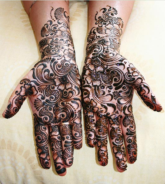 black shaded mehndi design for wedding brides