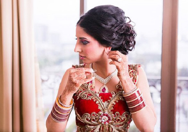 curly indian wedding bun with back coming