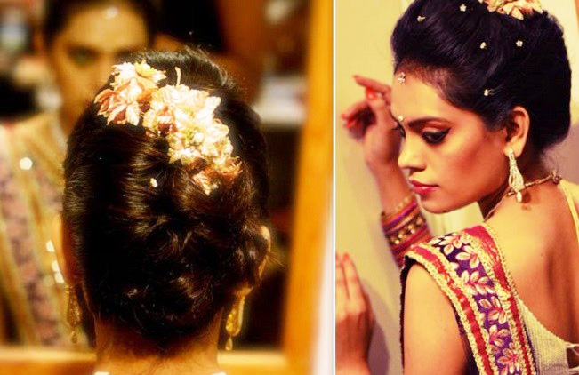 indian bridal classic bun with pearls and flowers