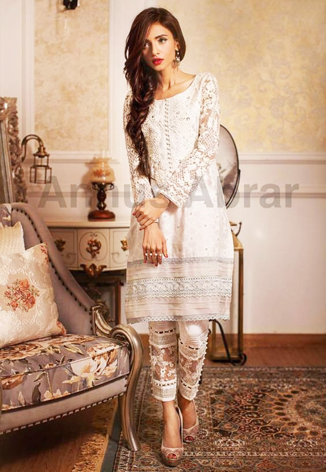 elegant white kurta paired with capri for formal wear