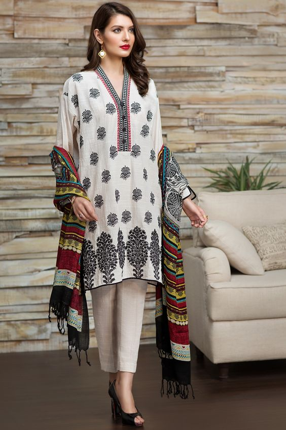 embroidered kurta paired with straight trouser and shawl