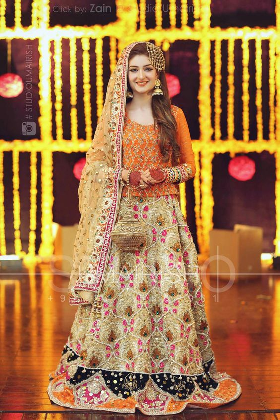 Orange choli with Beige and Pink Floral Lehenga