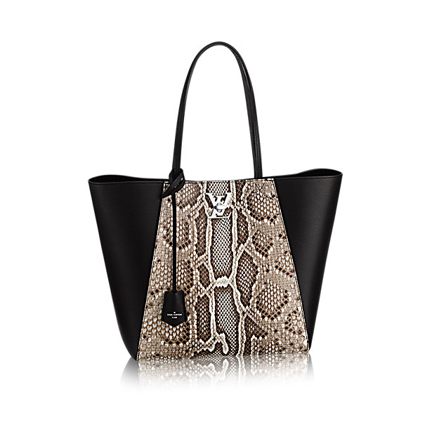 Printed Leather handbag by louis vuitton