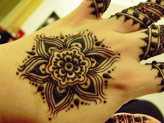 Enchanting Henna design with tikki