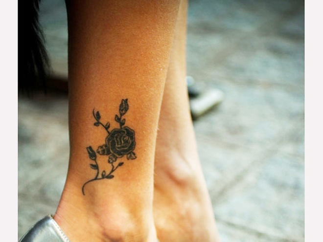 small black rose tattoo on ankle