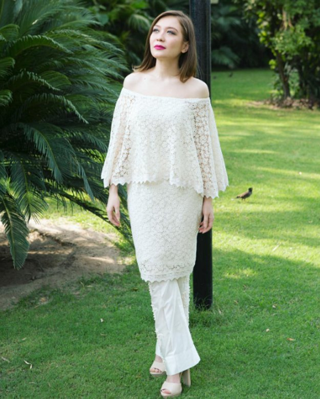 cape style white off the shoulder dress with trouser