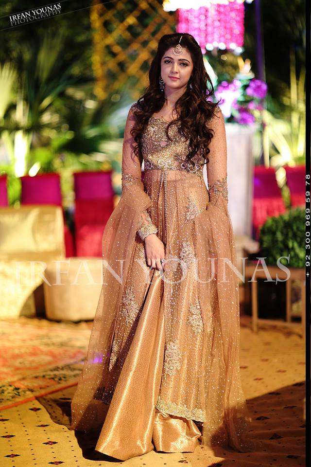 gold wedding wear frock with silver motifs paired with lehenga
