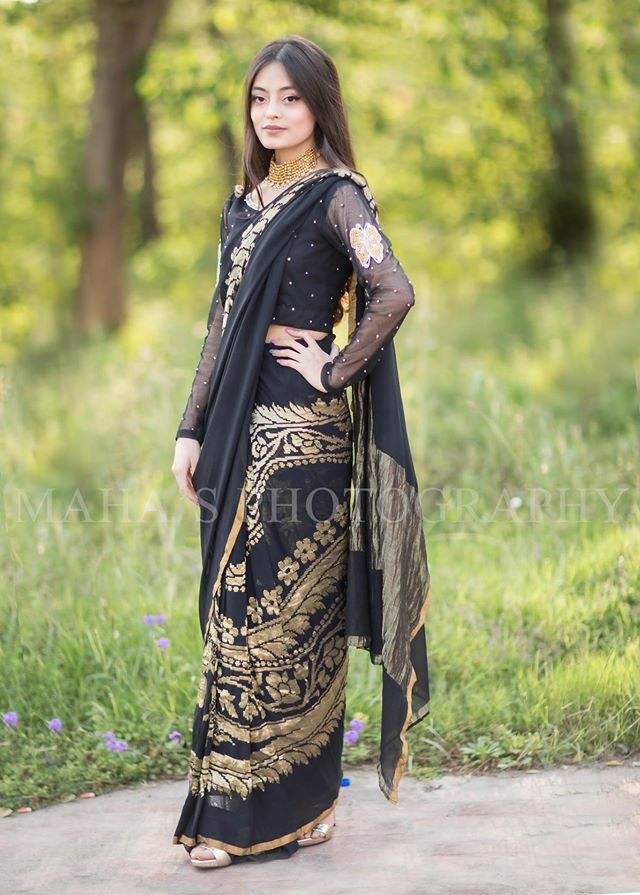 black bridal shower wear saree with golden work